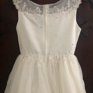 Girls white calf length dress.